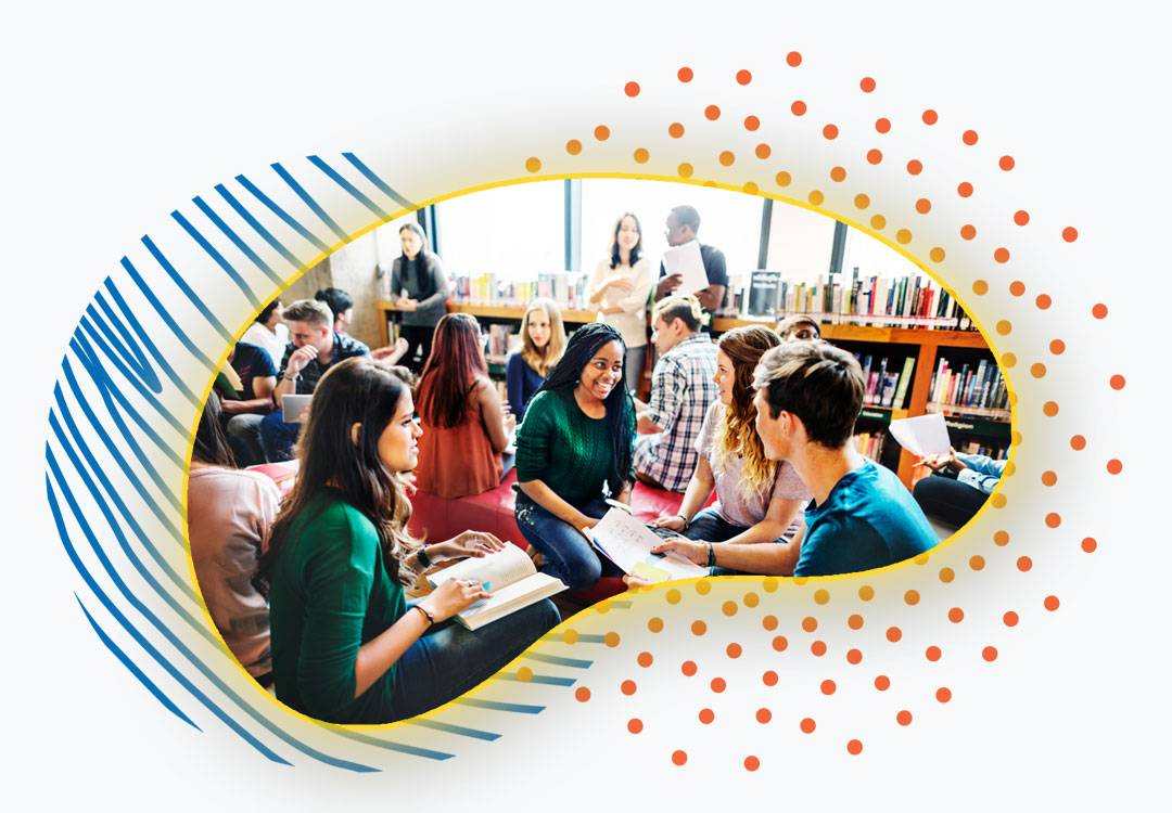 Group of students talking in a library